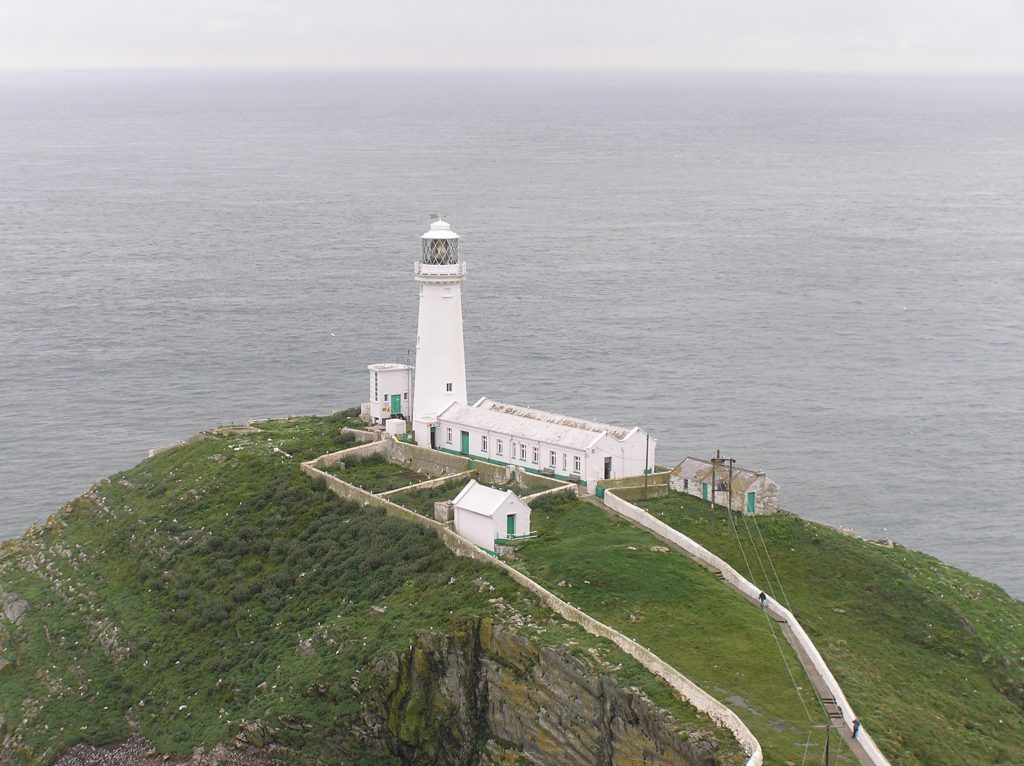 lighthouse and buildings on the island of south stack