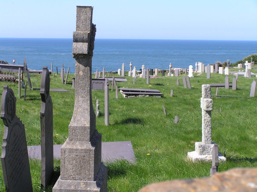 cliff top graveyard with tilting head stones at Llanbadrig church