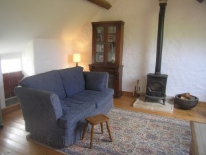 The Loft B&B cosy living room with wood burning stove in Church Bay Anglesey