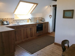 kitchen with views of the sea in The Loft B&B anglesey