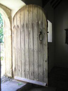 old wooden church door standing open