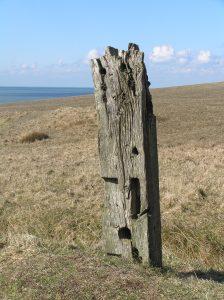 old wooden post on coastal path