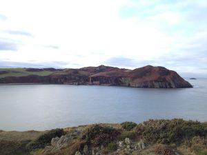 seascape with distant abandoned brickworks on the headlands at Porthwen