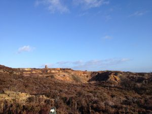 disused windmill on the skyline at an abandoned copper mine works