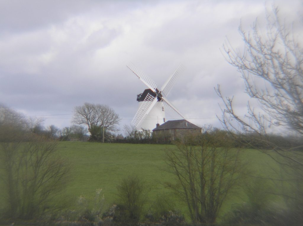 white windmill in a winter countryside at Llynnon Mill Llanddeusant