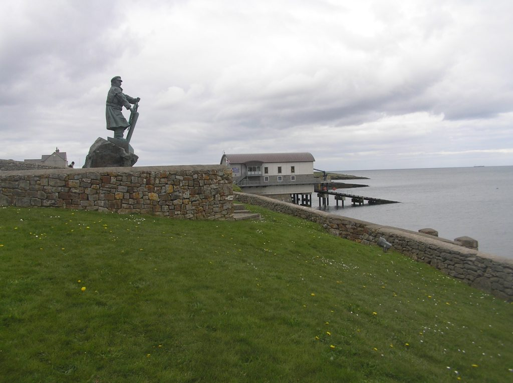 statue of Dick Evans at the seawatch centre, Moelfre and the new lifeboat station